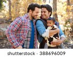 gay male couple with baby... | Shutterstock . vector #388696009