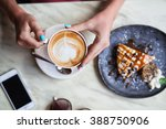 cappuccino cup in the girl... | Shutterstock . vector #388750906