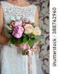 wedding flowers in her hands    Shutterstock . vector #388762960