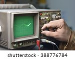 Small photo of Working with oscilloscope in laboratory