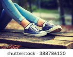 young woman in jeans and blue... | Shutterstock . vector #388786120
