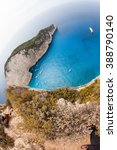 Small photo of Greece. The island of Zakynthos. View of the sea bay Navajo with blue water and sand are white. Many tourists who swim near an abandoned ship
