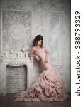 Stock photo studio portrait of beautiful young bride in pink dress perfect make up and hairstyle 388793329
