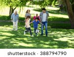 smiling family playing football ... | Shutterstock . vector #388794790
