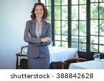smiling businesswoman posing... | Shutterstock . vector #388842628