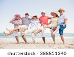 happy senior friends dancing on ... | Shutterstock . vector #388851340