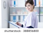 smiling young female doctor... | Shutterstock . vector #388856800