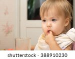 Small photo of Baby eating portrait thinking satiate