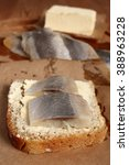 Small photo of Sandwich with pickled herring and butter. Salted, soused skinless slices of fish Clupea.