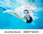Female Swimmer Gushing Through...