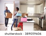 young couple moving in to new... | Shutterstock . vector #389059606