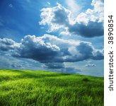 Green Grassland And Storm Cloud
