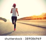 young woman runner athlete... | Shutterstock . vector #389086969