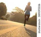 young fitness woman runner... | Shutterstock . vector #389095336