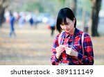 woman portrait in the park with ... | Shutterstock . vector #389111149