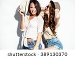 cheerful two young women in...   Shutterstock . vector #389130370