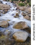 Small photo of A stream rushes down an Alluvial Fan in the Big Thompson River wash out zone, Rocky Mountain National Park, Colorado