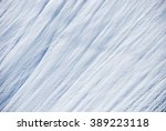 background made of snow on a... | Shutterstock . vector #389223118