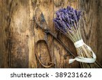 lavender wooden table beside... | Shutterstock . vector #389231626