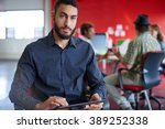 confident male designer working ... | Shutterstock . vector #389252338