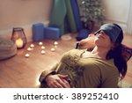 attractive mixed race woman... | Shutterstock . vector #389252410
