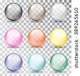 set of glass balls on a... | Shutterstock .eps vector #389265610