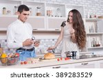 beautiful couple in the kitchen ... | Shutterstock . vector #389283529