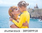 mother kissing daughter. happy... | Shutterstock . vector #389389918