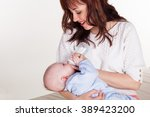 mom feeds the baby newborn... | Shutterstock . vector #389423200