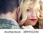 young couple embracing | Shutterstock . vector #389452240