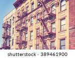 old film retro toned photo of... | Shutterstock . vector #389461900