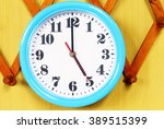 clock on the wood background | Shutterstock . vector #389515399