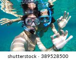 Young Couple Snorkeling In The...