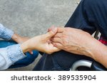 close up  hand holding hand on... | Shutterstock . vector #389535904