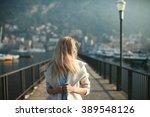 blonde girl in a coat walks on...   Shutterstock . vector #389548126