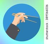 hand holding chopsticks flat... | Shutterstock .eps vector #389566036