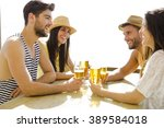 friends having fun and drinking ... | Shutterstock . vector #389584018