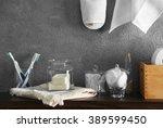 bath accessories on grey wall