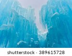 translucent blue icicles in a... | Shutterstock . vector #389615728