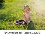 a sweet little girl sitting... | Shutterstock . vector #389622238