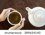 tea time. girl holding a cup of ... | Shutterstock . vector #389654140