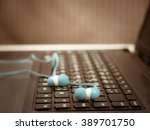 laptop computer with headset on ... | Shutterstock . vector #389701750