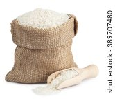 Small photo of White long rice in a sack and wooden scoop isolated on white background