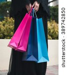 Small photo of Woman in Abaya Is Holding Shopping Bags Close Up