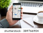 man hand holding phone with... | Shutterstock . vector #389766904