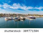 port piraeus in a summer day in ... | Shutterstock . vector #389771584
