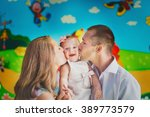young parents kissing their... | Shutterstock . vector #389773579