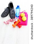 fitness concept with dumbbells... | Shutterstock . vector #389794240
