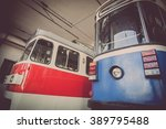 Small photo of Color image of some trams in a tram depot.