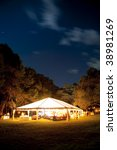 large event tent lit up at night - stock photo